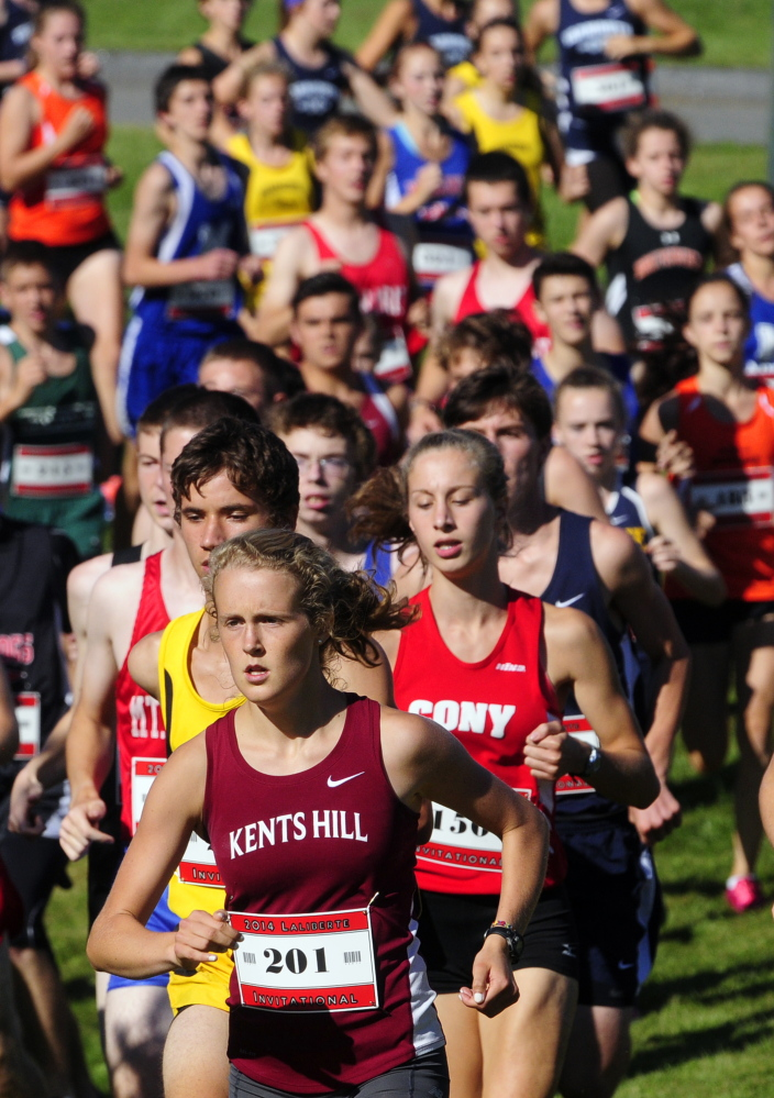 Kents Hill runner Anne McKee (201) leads Cony's Anne Guadalupi during the 15th annual Laliberte Invitational last Aug. 29 at Cony High School in Augusta.