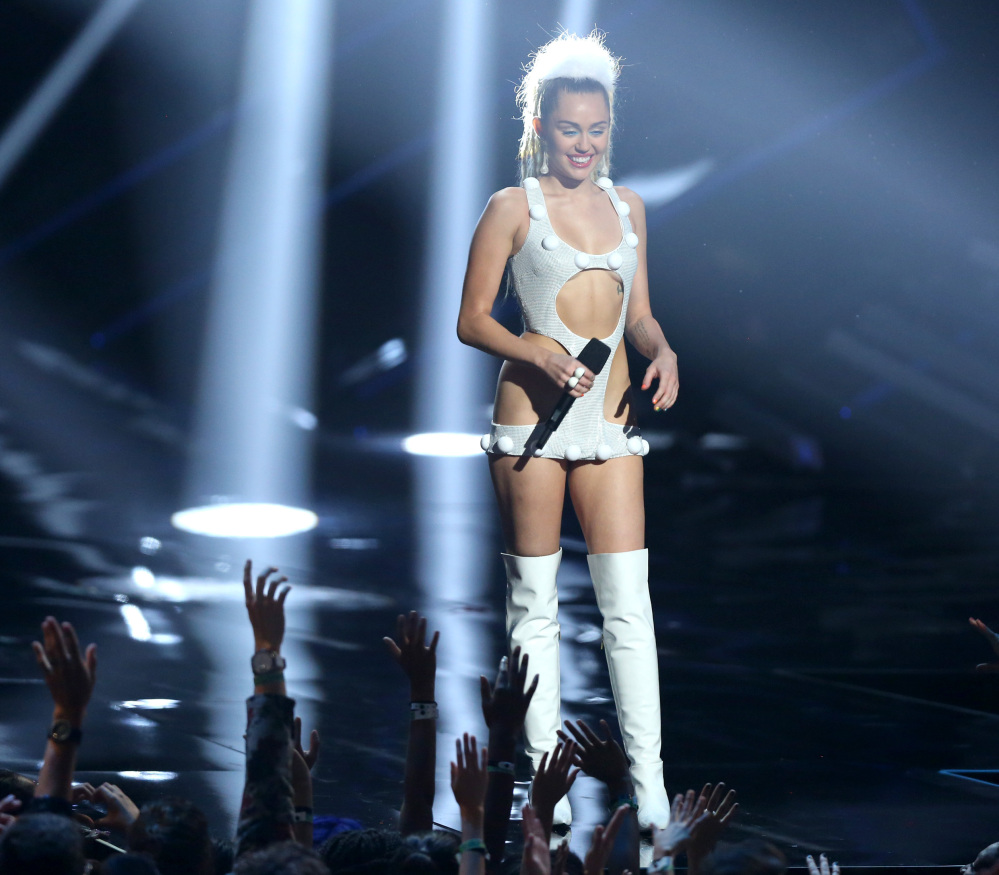 """Miley Cyrus appears at the MTV Video Music Awards on Sunday. Cyrus had criticized Nicki Minaj for being a poor sport and for a """"war"""" with Taylor Swift."""