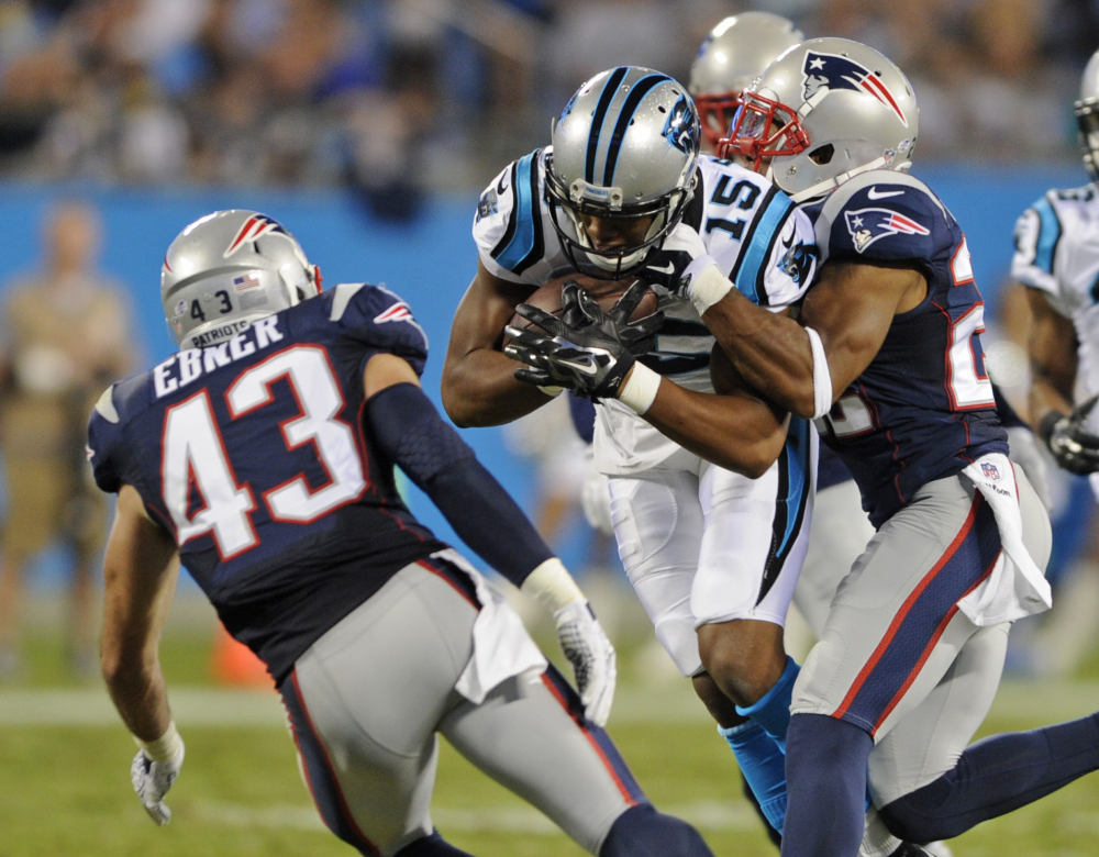 Carolina Panthers' Jarrett Boykin (15) is tackled by New England Patriots' Robert McClain (22) and Nate Ebner (43) during the second half of a preseason game last week in Charlotte, N.C.