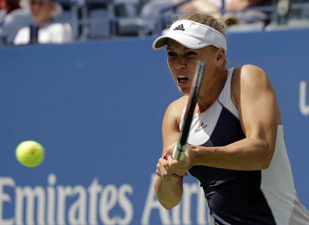 Caroline Wozniacki returns a shot to Jamie Loeb during the first round of the U.S. Open on Tuesday in New York.