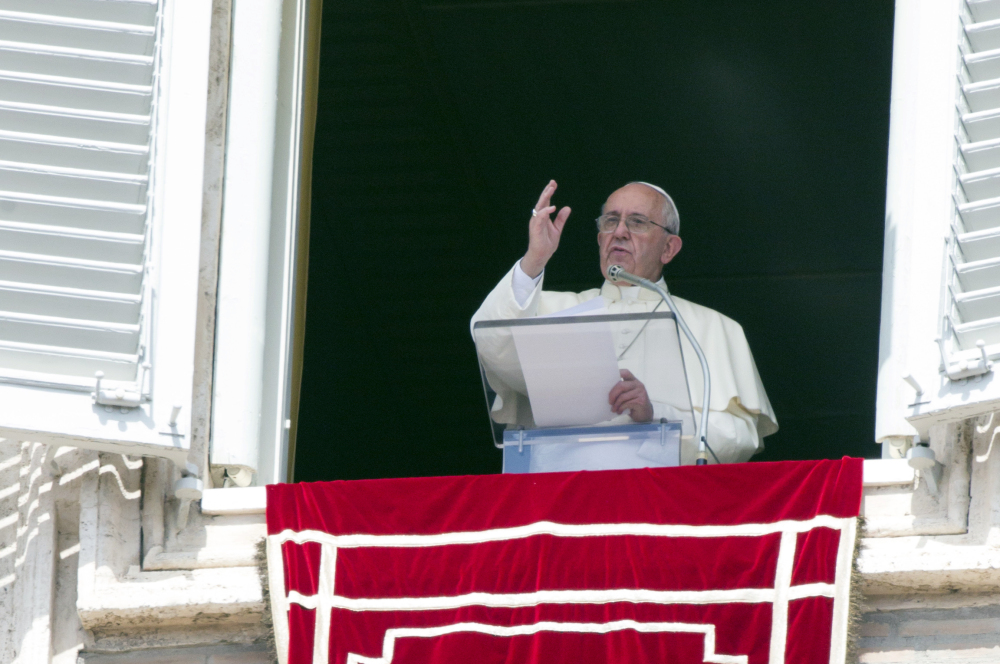 Pope Francis delivers his blessing to faithful during the Angelus noon prayer from his studio window overlooking St. Peter's Square at the Vatican, Sunday.