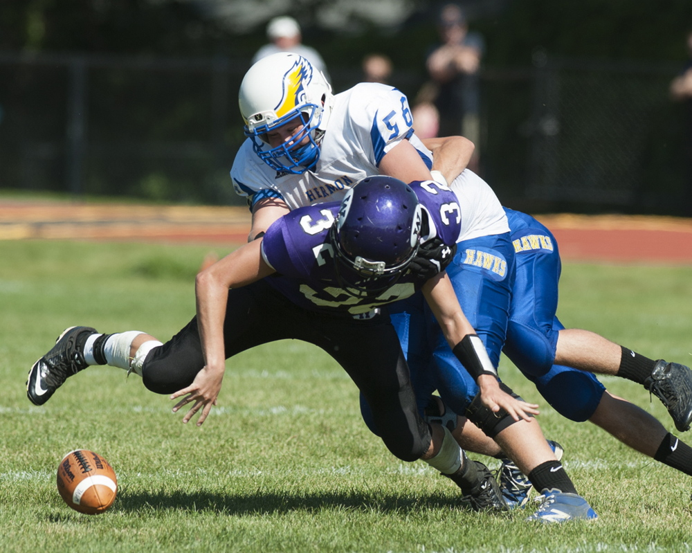 Kevin Bennett photo   Hermon's Garrett Mullen knocks the ball free as he brings down Waterville's Gavin LaChance during the second quarter Saturday in Waterville.