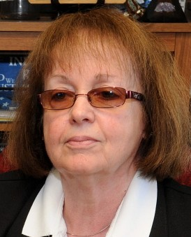 Claudia Viles sits at her desk at the town office in Anson in this file photo. The town's tax collector for 42 years resigned Thursday after selectmen told her she couldn't handle money anymore, because the Maine Municipal Association, which handles the town's insurance, can't bond her.