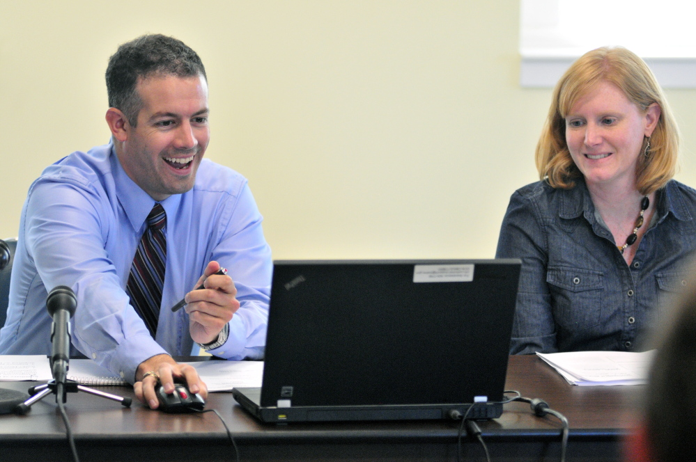 Director of the Office Policy and Management Jonathan LaBonte, left, and Land For Maine's Future Director Sarah Demers are seen Tuesday during a meeting of the Land For Maine's Future board in Augusta. There were four public members there but the board didn't have a quorum because none of the three commissioners attended.