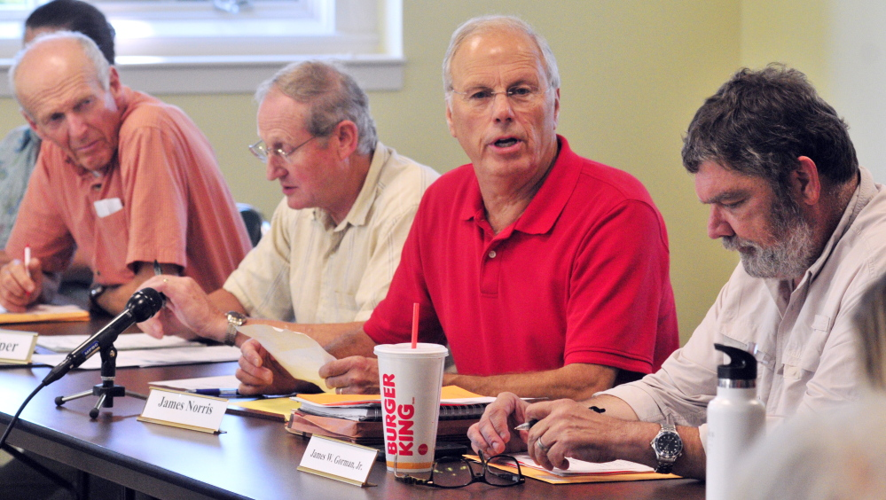 Public members of the board Ben Emory, left, Neil Piper, James Norris and James W. Gorman Jr., are seen during a meeting of the Land For Maine's Future board on Tuesday in Augusta. There were four public members there but the board didn't have a quorum because none of the three commissioners attended.
