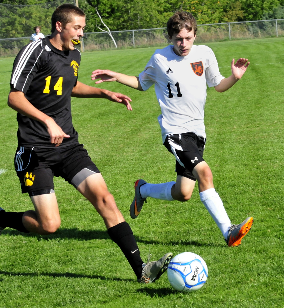 Staff photo by David Leaming   Maranacook's Hayden Elwell, left, and Winslow's Isaac Lambrecht chase the ball during game Thursday in Winslow.