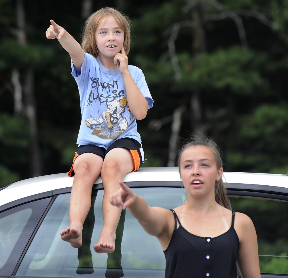 Abbey Steinhagen, 10, and her sister Nicole Steinhagen, 19, from South Portland, point out the planes flying over Fat Boy Drive In in Brunswick. Gordon Chibroski/Staff Photographer