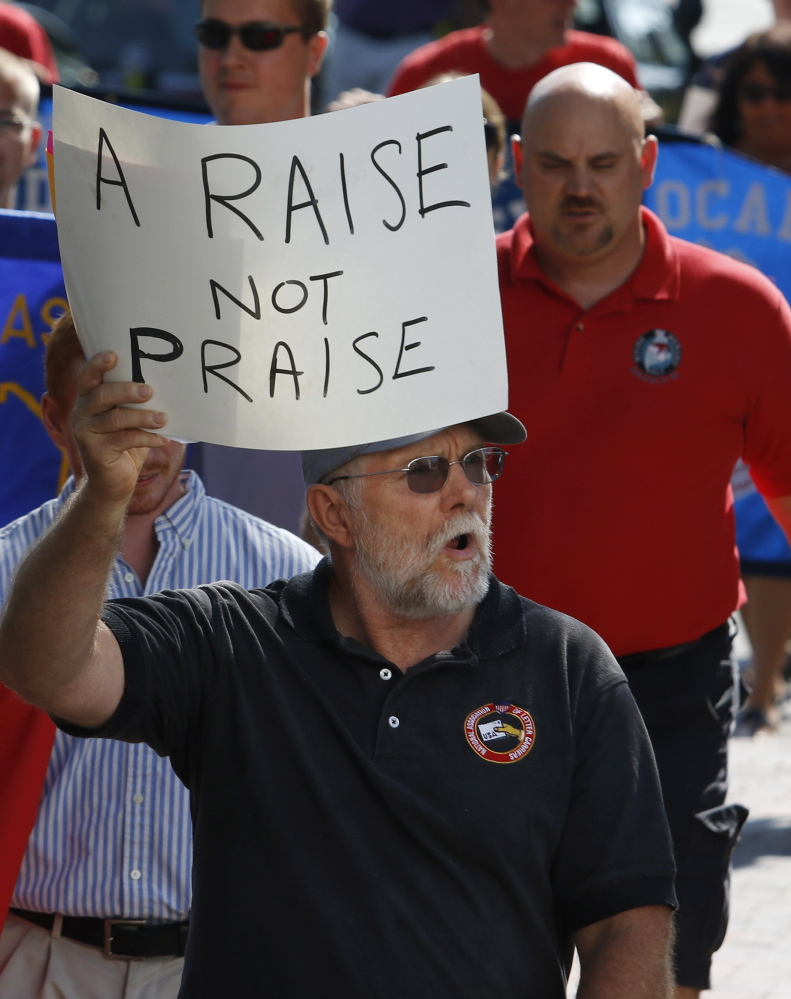 John McGregor, a member of the National Association of Letter Carriers, participates in the Labor Day march Monday in Portland.
