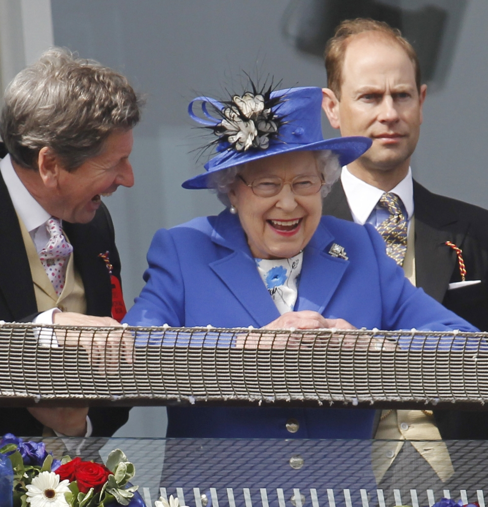 Britain's Queen Elizabeth II, smiles during a Diamond Jubilee celebration June 2 to mark the 60th anniversary of her accession to the throne. On Wednesday, she breaks Queen Victoria's record for longevity of reign.