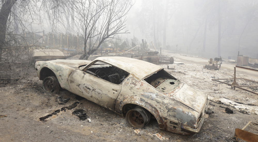Fires that once stayed primarily on forested land have been moving into neighborhoods this summer, leaving cars and buildlings destroyed at drought-ridden Mountain Ranch, Calif.