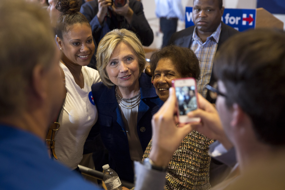 Democratic presidential candidate Hillary Clinton, seen posing for photos with supporters during an event in Iowa on Monday, plans another 'grass-roots organizing meeting' on Friday in Portland.