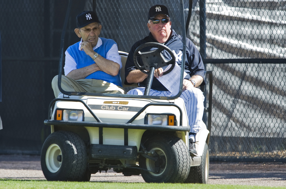 Hall of Famer Yogi Berra, left, and Maine native Stump Merrill watch a workout in 2011 at the Yankees' spring training camp in Tampa, Florida. Merrill was a special instructor at the camp, and one of his other duties in recent years was to escort Berra, who was approaching 90.