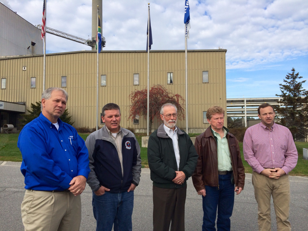 Tony Ouellette, managing director of the Sappi Somerset Mill, far left, stands with state legislators, from left to right, Maine Senate President Michael Thibodeau, Sen. Rod Whittemore, Sen. Bill Diamond and Maine House Speaker Mark Eves at the mill in Skowhegan on Thursday.