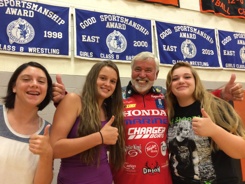 """Ray Brazier, one of the hosts of """"Fishing University,"""" visits with area students at Winslow High School in September while the show was filming on China Lake and in Waterville. Brazier and co-host Charlie Ingram met with students from the high school and Mid-Maine Technical Center at the school. The names of the students pictured were not available."""