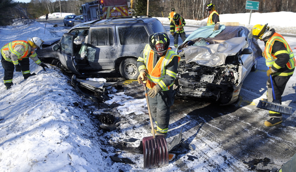 Monmouth firefighters collect debris from a two-car collision that killed Joan Fortier on March 6, 2014, on Route 202 in Monmouth. Her husband, John Fortier of Mount Vernon, has filed a lawsuit seeking damages against the drivers involved.