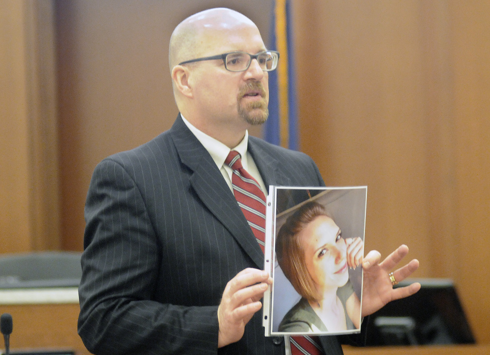 Assistant Attorney General Donald Macomber holds a photo of Jillian Jones during opening arguments of the murder trial of Justin Pillsbury in this March 14 file photo.