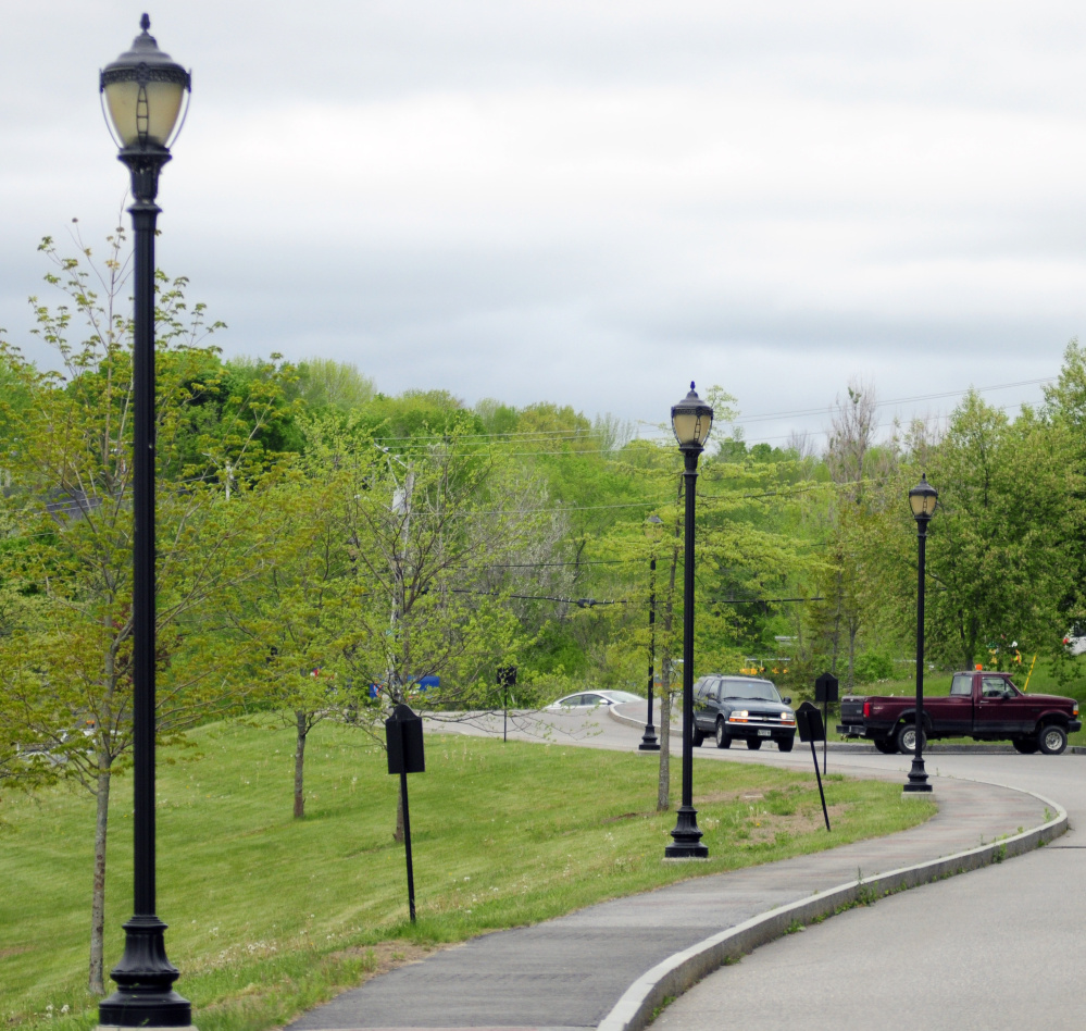 Street lights on Canal Street in Augusta, shown in this Tuesday photo, would be replaced with energy-efficient bulbs under a proposal before Augusta City Council.