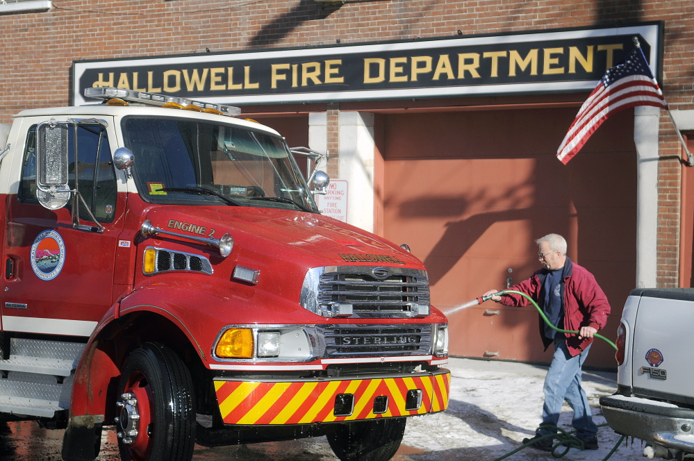Richard Clark washes a Hallowell fire engine in 2015 at the city's station on Second Street. A committee is discussing whether to move the city's firetrucks and crew from the outdated fire station to a new location or partner with a surrounding community for fire protection services.