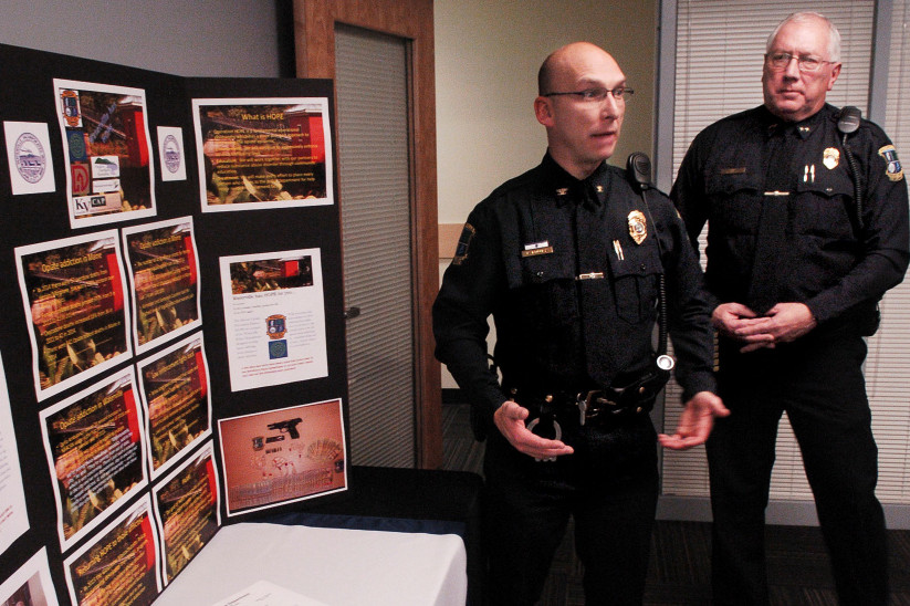 Waterville police Deputy Chief Bill Bonney, left, and Chief Joe Massey speak beside a display of opiate drugs and statistics on the increase of drug use after announcing a new program called Operation HOPE, or Heroin Opiate Prevention Effort, during a news conference Wednesday. The program combines enforcement, education and treatment for drug users.