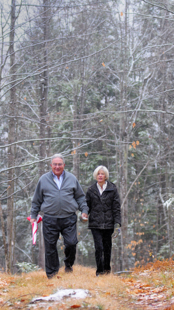 John and Lisa Rosmarin pose for a portrait on Friday in Readfield on land they donated to the Kennebec Land Trust.