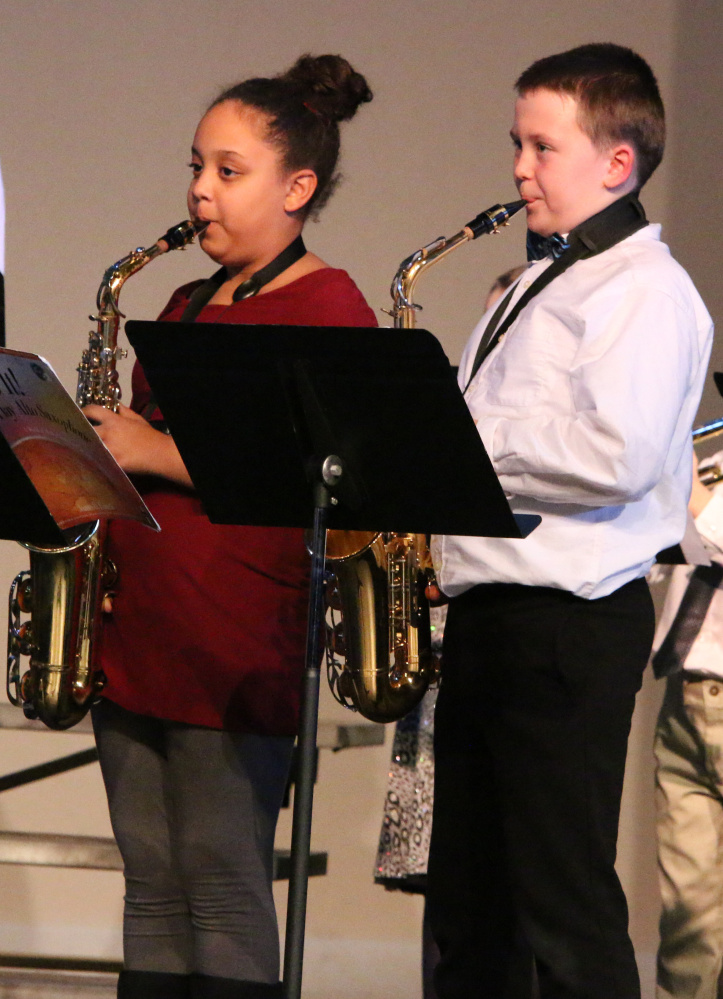 Madison Quimby, left, and Nash Corson perform in Benton Elementary's Holiday Concert on De. 15.