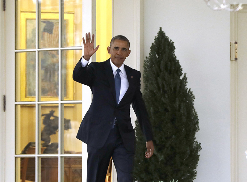 President Barack Obama waves as he leaves the Oval Office of the White House on Jan. 20.