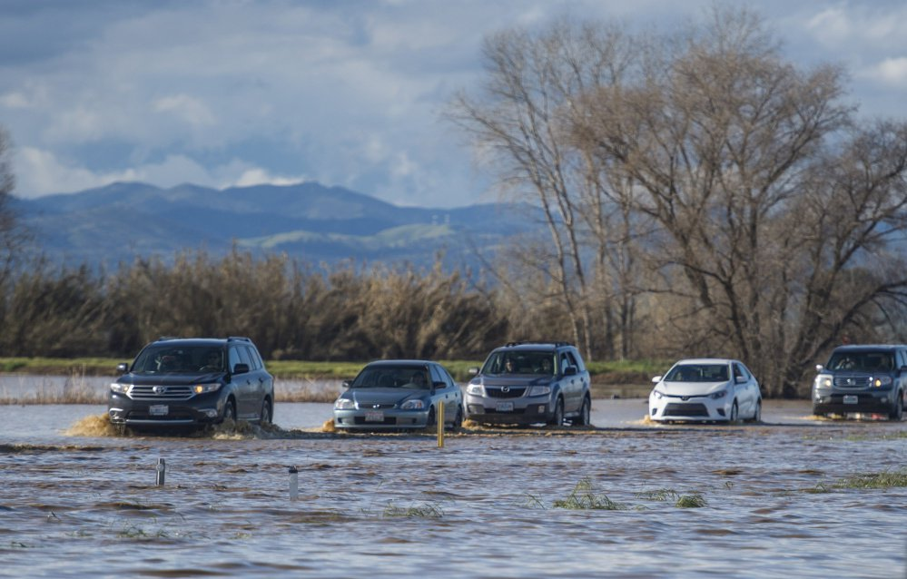 A flooded Interstate 5 snarls traffic for miles in Maxwell, Calif., on Saturday.