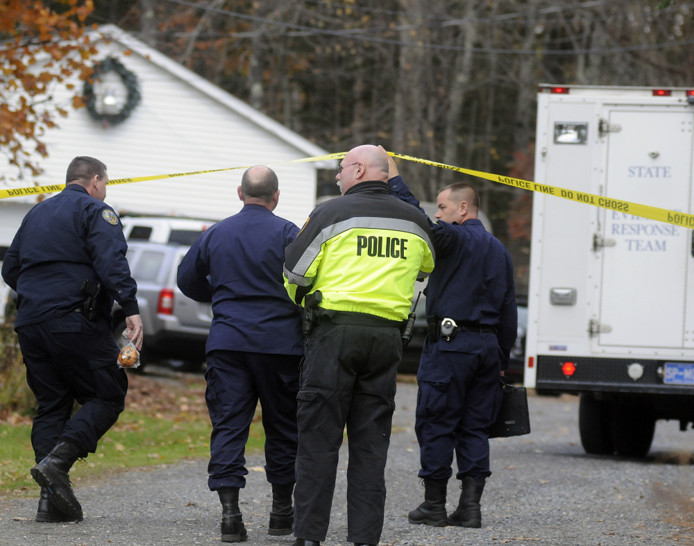 Maine State Police detectives enter the driveway Oct. 31, 2016, at a home in Winthrop where the bodies of Antonio and Alice Balcer were found early in the morning.