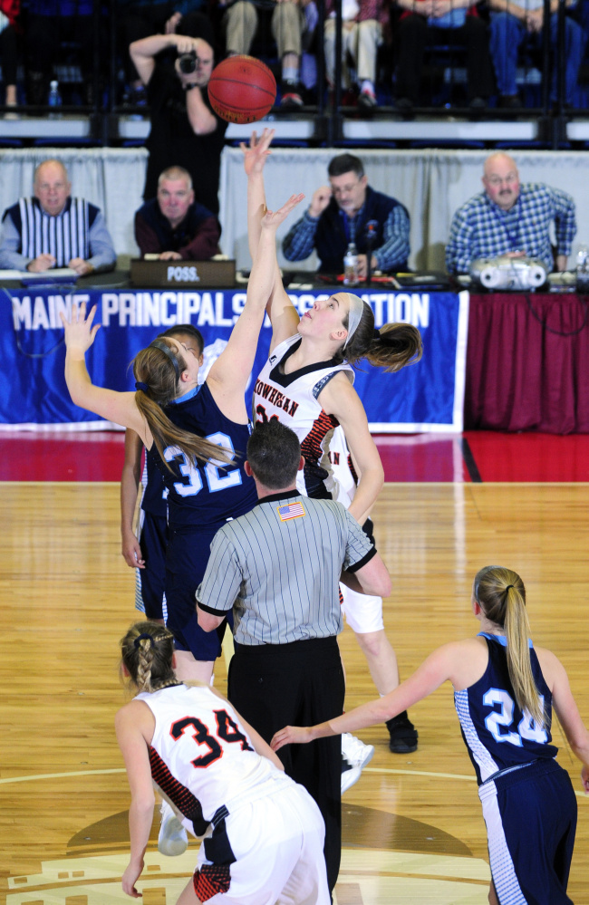 Oceanside's Alexis Mazurek, left, and Skowhegan's Annie Cooke battle for a rebound during a Class A North quarterfinal game Friday at the Augusta Civic Center.