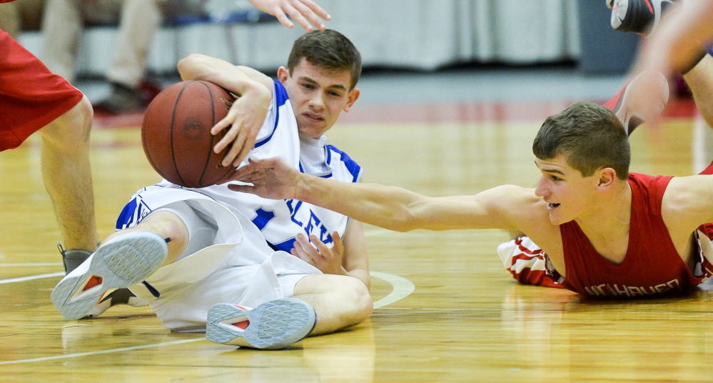 Valley sophomore Joey Thomas tries to keep the ball away from Vinalhaven defender Max Stanley in a scuffle over the ball in the second half of a Class D South quarterfinal Saturday in Augusta.
