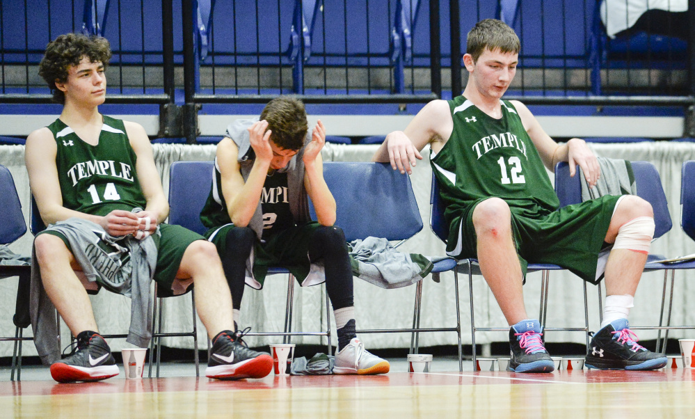 Temple players, from left, Noah Shepard, Micah Riportella and Bradley Smith take in the waning seconds of a 76-63 loss to A.R. Gould in a D South quarterfinal game Saturday morning at the Augusta Civic Center.