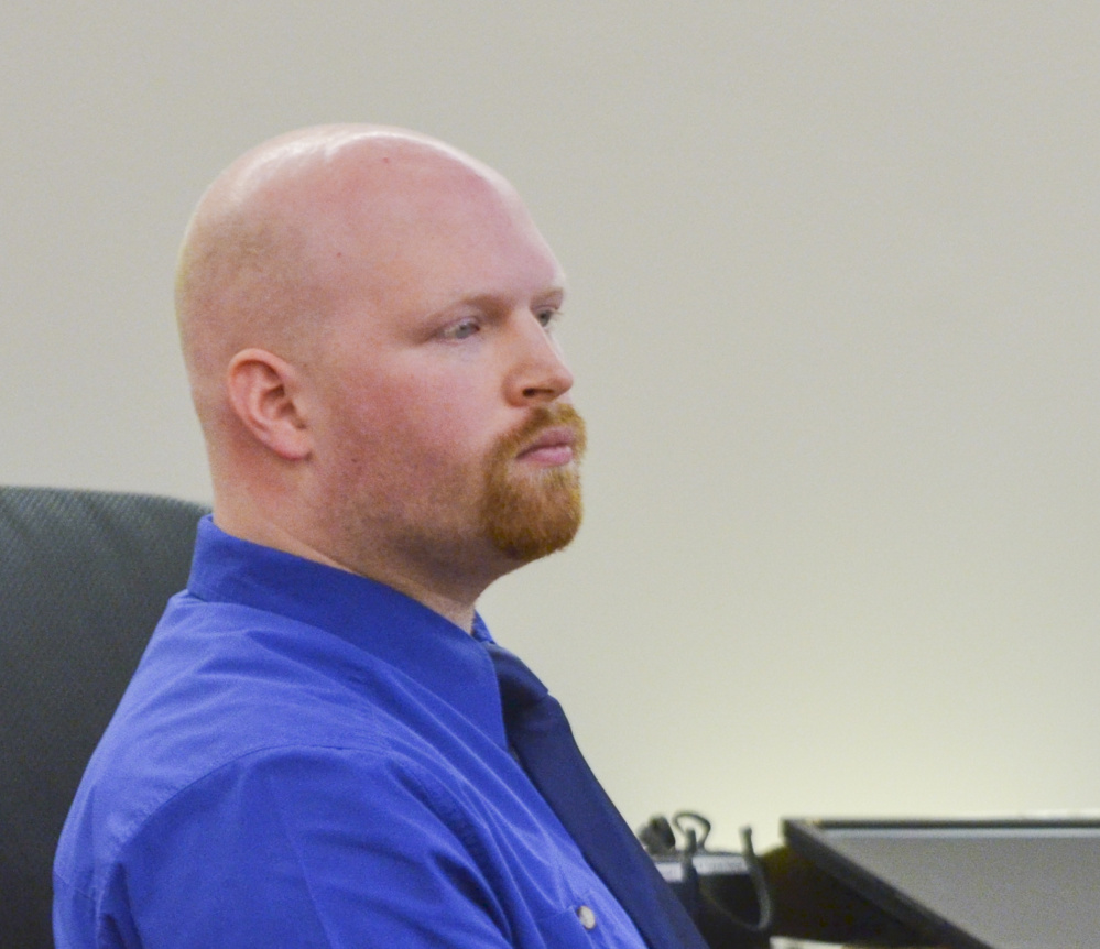 Lucas Savage, 28, of Clinton, listens Tuesday during his trial on a charge of unlawful sexual contact with a 10-year-old girl.