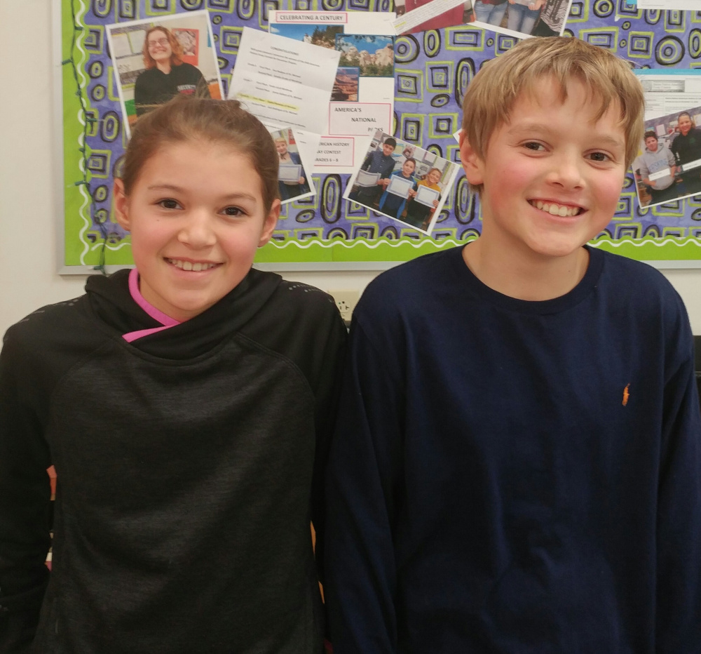 Courtney Cowing, left, a Windsor Elementary sixth grade student, was named the winner of the Canines for Charity National Essay and Art Contest for grades 6-8. Carson Appel, also a Windsor Elementary student, was named runner-up.