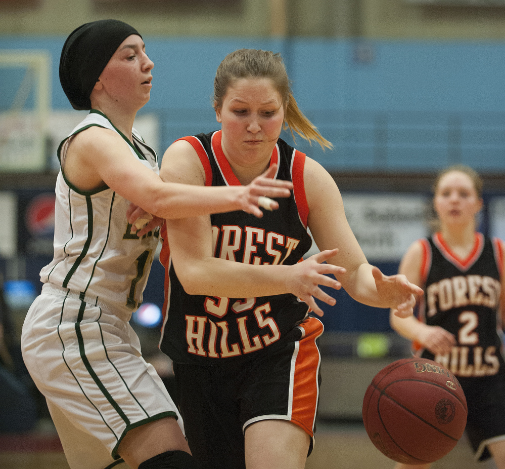 Photo by Kevin Bennett   Forest Hills' Madison Cuddy drives to the basket as Rangeley's Brooke Egan defends during a Class D semifinal Thursday at the Augusta Civic Center.
