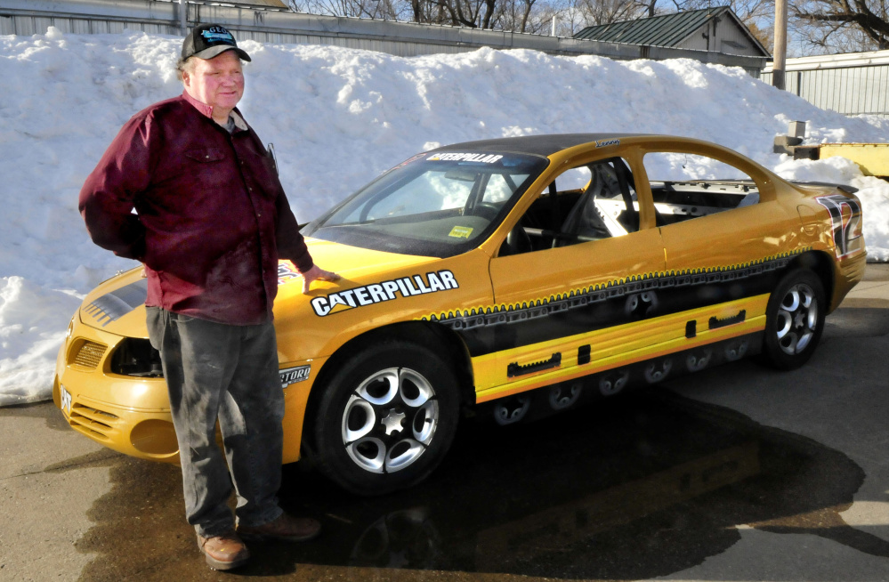 George Fernald, owner of Unity Raceway, has plans for this season at the race track as he shows off a stock car he built at his shop in Benton on Wednesday.