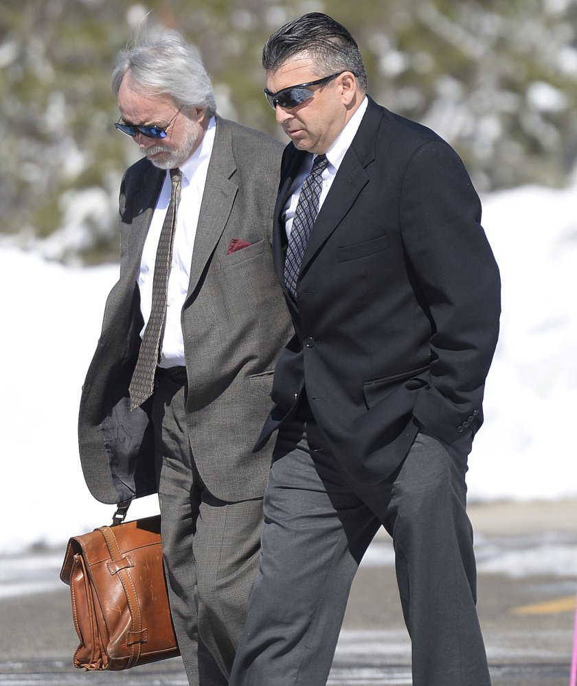 Former Ogunquit town manager Thomas Fortier, right, enters court in York with attorney Bruce Merrill on Thursday. Fortier's case is headed for trial.