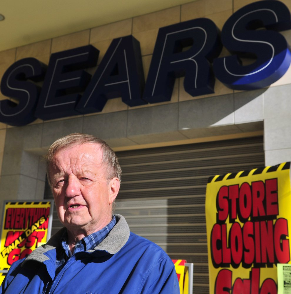 Former Sears employee Cal Brown stands in front of the Augusta Sears that, like so many others of its kind, will soon close as modern shopping trends online and elsewhere.