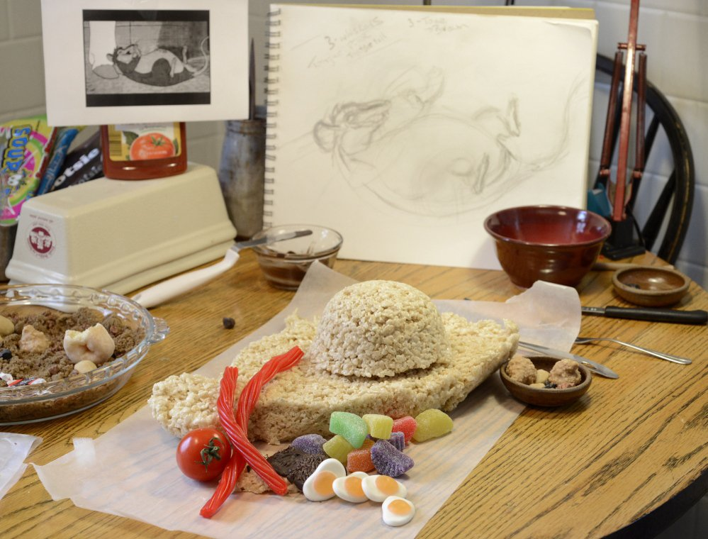 "Deborah Klotz of Portland is taking on ""Charlotte's Web"" for the Edible Book Festival. Assorted ingredients on her table will make Templeton the Rat."