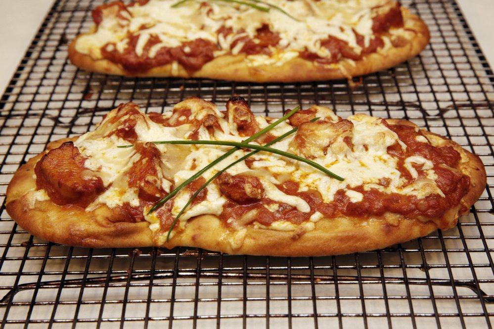 The small size and light and airy texture of store-bought naan make it a shoe-in for a quick pre-made pizza crust.