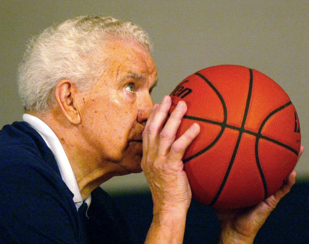 Keeping his shooting elbow in, Dr. Tom Amberry aims a free throw. Amberry, a California podiatrist, made history in 1993 when he shot 2,750 consecutive free throws. He died during the NCAA's March Madness season this year.