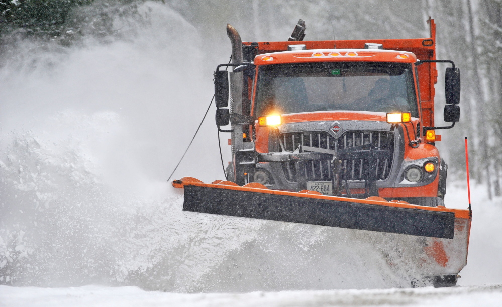 A plow truck with the Waterville Public Works clears fresh snow during a storm in February. A late-winter storm Tuesday into Wednesday is forecast to bring a foot or more of snow to central Maine.
