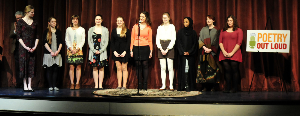 The 10 high school students assemble on stage prior to competing in the Poetry Out Loud finals at the Waterville Opera House on Monday. The winner of the state finals — Gabrielle Cooper of Gardiner Area High School — will move on to national competition in Washington, D.C. The event is organized by the National Endowment for the Arts and Poetry Foundation and administered by the Maine Arts Commission.