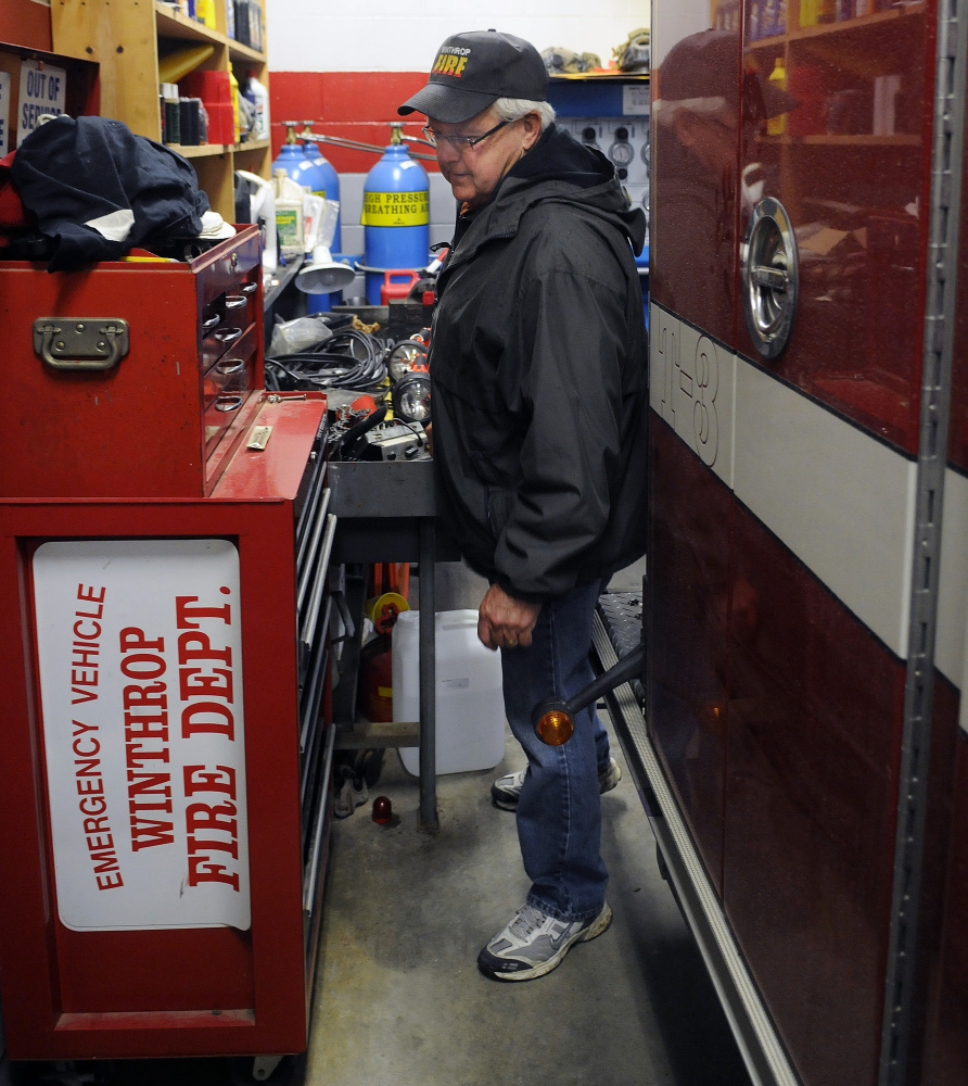 Winthrop Deputy Fire Chief Dave Currie squeezes between a work area and a firetruck April 12, 2016, at the town's station. On Monday, Winthrop's Town Council unanimously accepted a contractor's $1.8 million bid to build a larger station on U.S. Route 202.