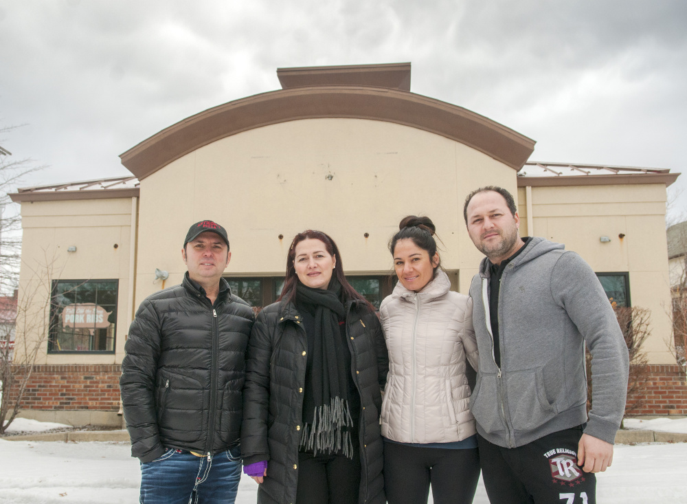 From left, Kastroit Xhollo, Antigoni Papagjaki, Ermira Martiko and Ervin Papagjaki stand on Wednesday outside a former Pizza Hut, a location that they are planning to turn into Antigoni's Augusta, on Bangor Street in Augusta.
