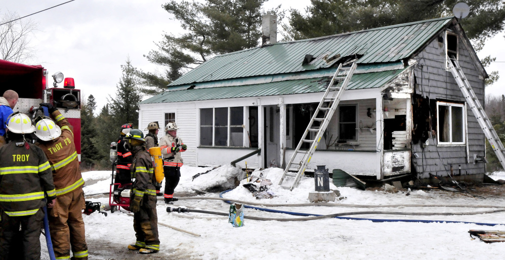 Firefighters from seven area departments went to fight a house fire that destroyed a home Friday on Barker Road in Troy.