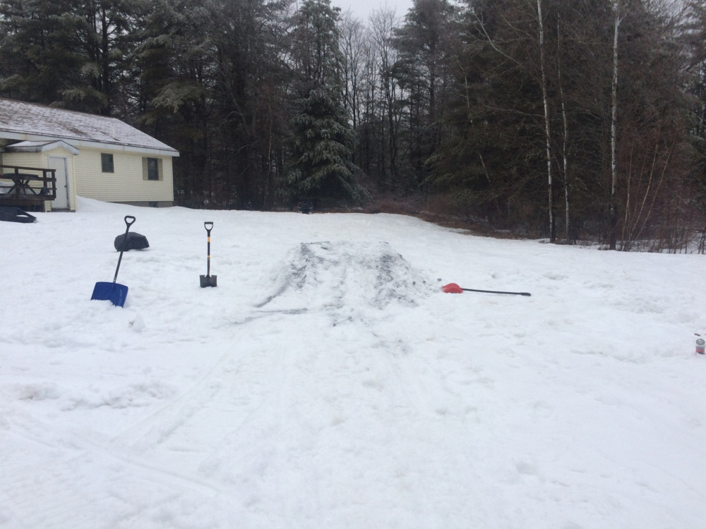 The scene of a residence on Hinckley Road in Canaan, where a teenager broke his leg after attempting to jump off a friend's homemade snow ramp on a snowmobile.