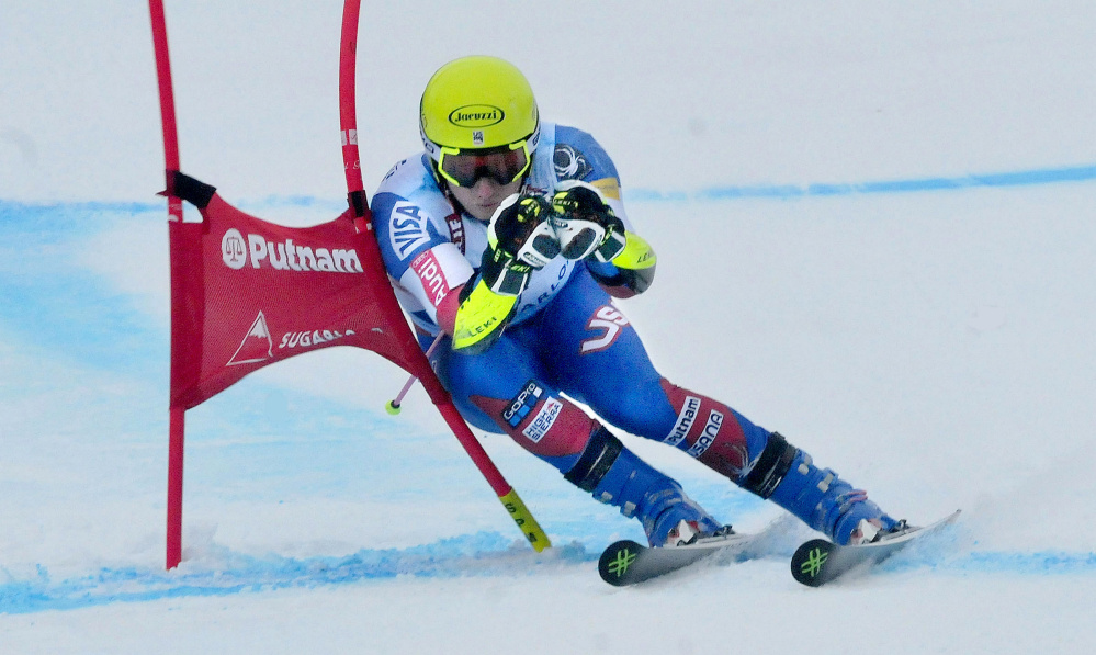 Tim Jitloff skis around a gate toward the finish line during a giant slalom race at the U.S. Alpine Championships Tuesday at Sugarloaf Mountain.