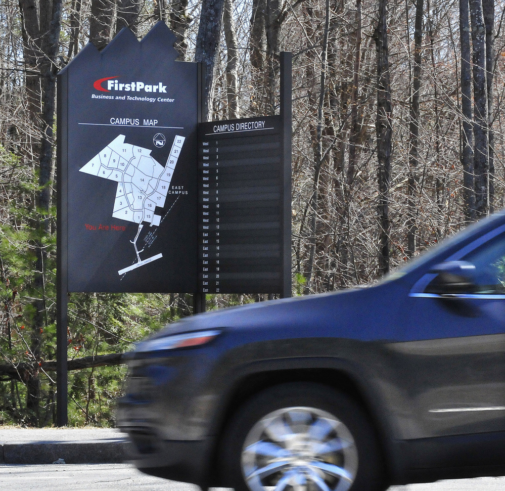 A motorist passes a FirstPark directory sign on April 14, 2016, at the business facility in Oakland.