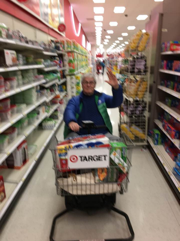 J.P. Devine, seen in his golden electric cart, patrols of aisles at Target.