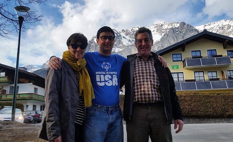 Lucas Houk poses for a photo with his parents after their arrival in Austria on March 14.